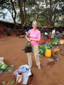 Dr. Lynda Wilson buying vegetables for dinner at market near Mulanje