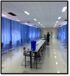 Room set up with exam rooms and hand washing station at the end of the tables.